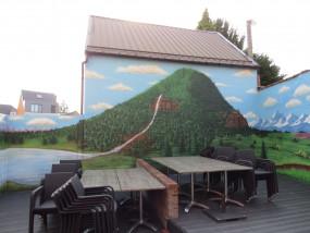 Muurschildering buiten terras restaurant landschap
