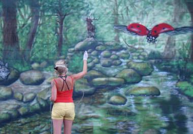 Streetart graffiti muurschildering trompet l'oeil muurschildering buiten