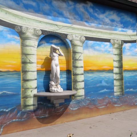Muurschildering buiten zee zonsondergang terras Griekenland